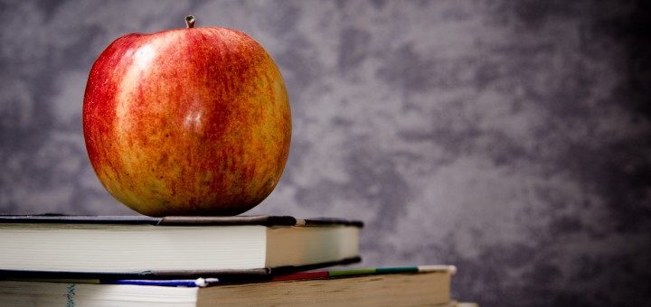 close-up-of-apple-on-pile-of-books